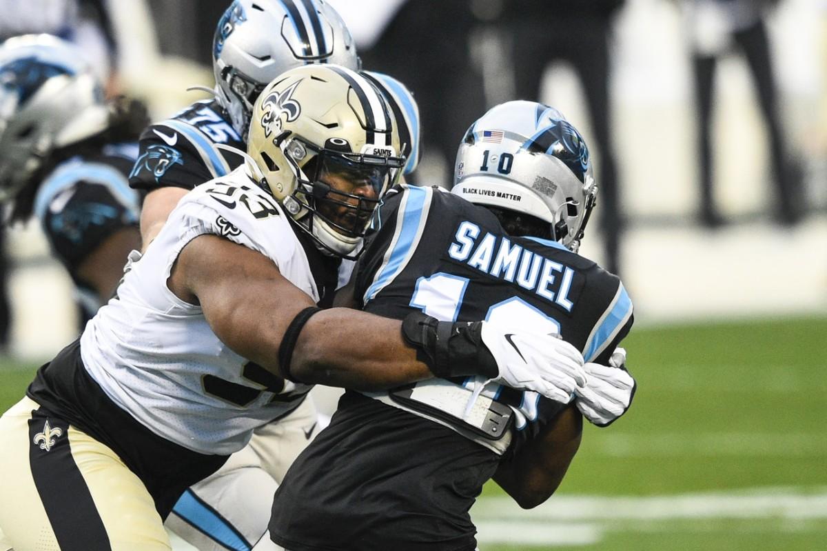 Jan 3, 2021; Charlotte, North Carolina, USA; Saints defensive tackle David Onyemata (93) tackles Panthers receiver Curtis Samuel (10). Mandatory Credit: Bob Donnan-USA TODAY