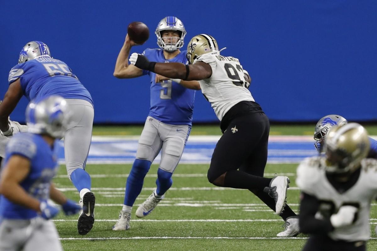 Oct 4, 2020; Detroit, Michigan, USA; Lions quarterback Matthew Stafford (9) gets pressured by New Orleans Saints defensive tackle David Onyemata (93). Mandatory Credit: Raj Mehta-USA TODAY