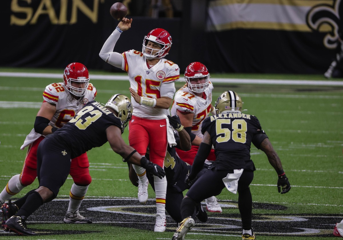 Dec 20, 2020; New Orleans, Louisiana, USA; Chiefs quarterback Patrick Mahomes (15) fumbles as Saints defensive tackle David Onyemata (93) hits him. Mandatory Credit: Derick E. Hingle-USA TODAY