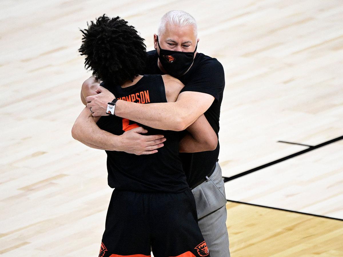 Wayne Tinkle hugs Ethan Thompson