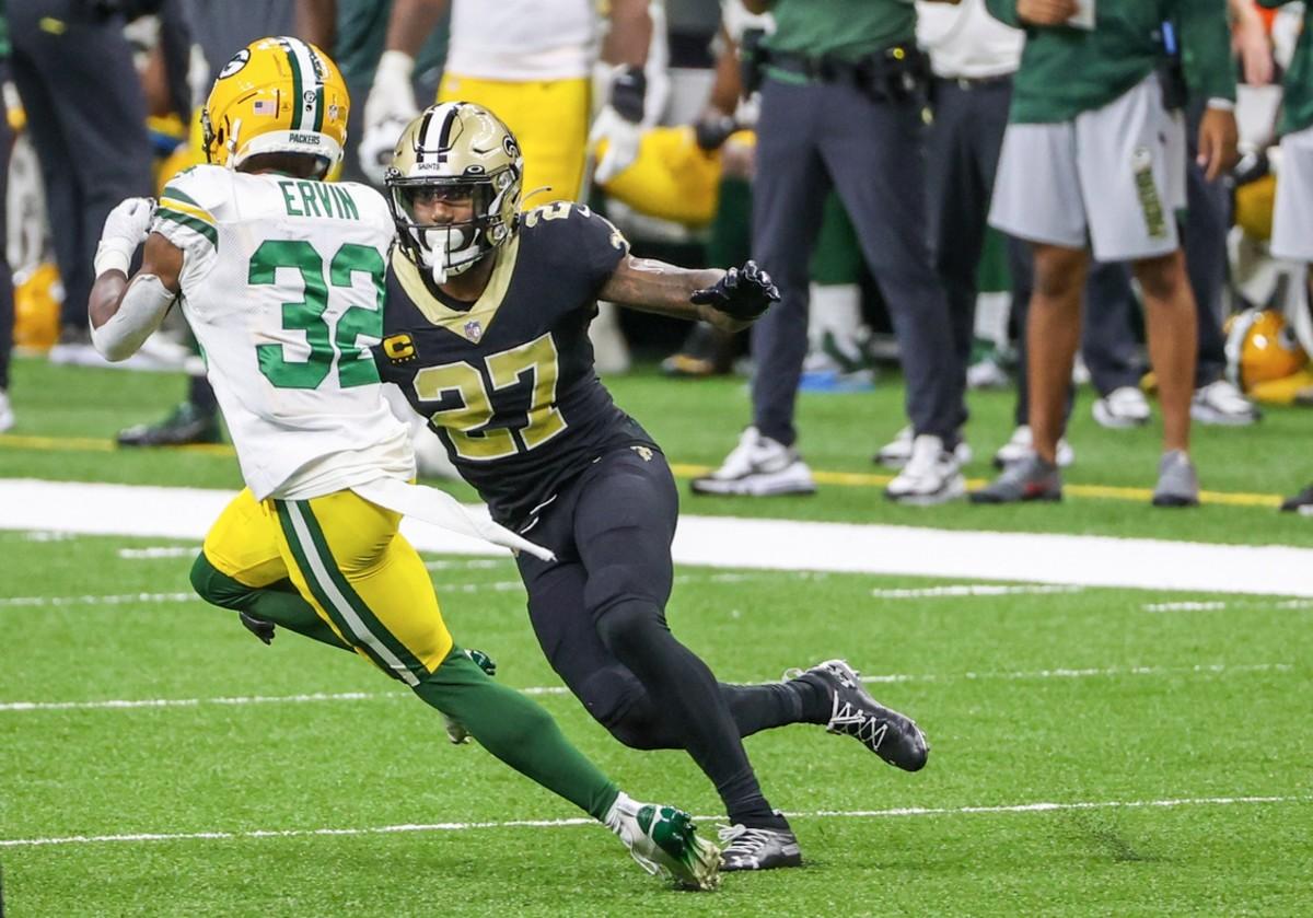 Sep 27, 2020; New Orleans, Louisiana, USA; Saints safety Malcolm Jenkins (27) pursues Green Bay running back Tyler Ervin (32). Mandatory Credit: Derick E. Hingle-USA TODAY Sports