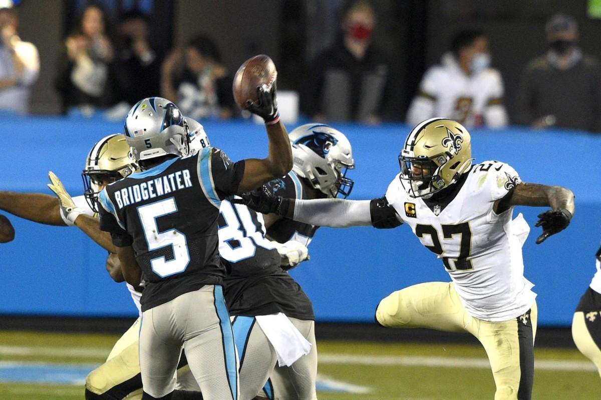 Carolina Panthers quarterback Teddy Bridgewater (5) looks to pass as Saints safety Malcolm Jenkins (27) pressures. Mandatory Credit: Bob Donnan-USA TODAY