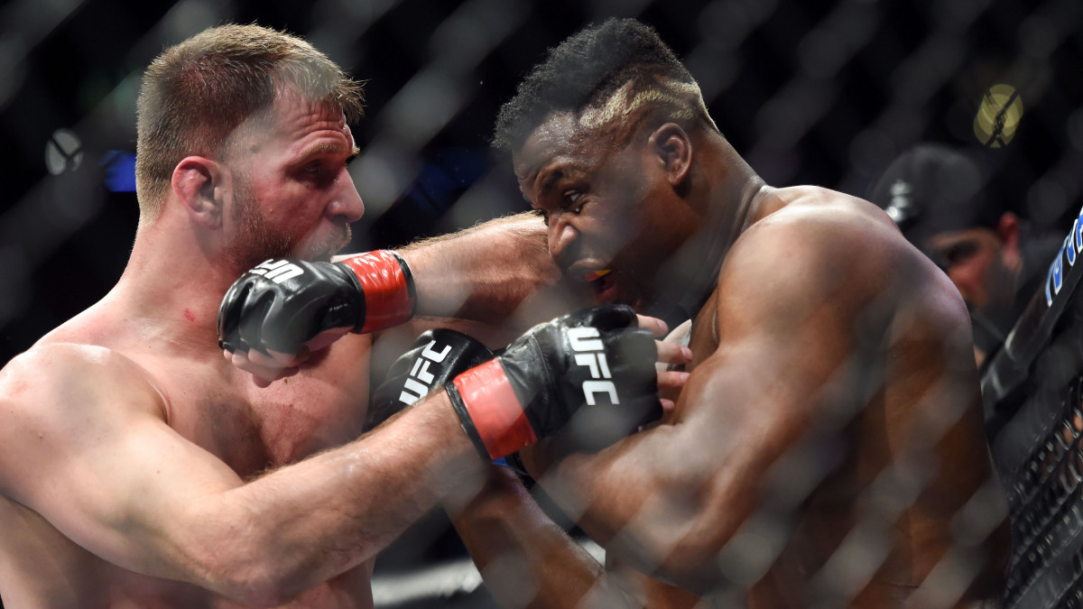 Stipe Miocic (red gloves) fights Francis Ngannou (blue gloves) during UFC 220 at the TD Garden.