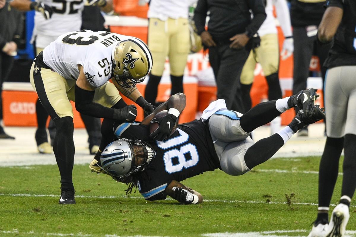 Jan 3, 2021; Charlotte, North Carolina, USA; Panthers tight end Ian Thomas (80) is tackled by New Orleans Saints linebacker Zack Baun (53). Mandatory Credit: Bob Donnan-USA TODAY Sports