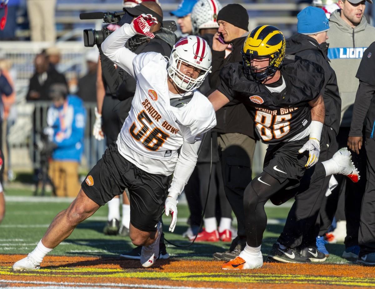 Jan 21, 2020; Mobile, Alabama, USA; Zack Baun of Wisconsin (56) works around tight end Sean McKeon of Michigan (86) during Senior Bowl practice. Mandatory Credit: Vasha Hunt-USA TODAY Sports
