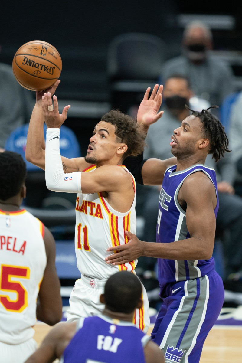 Trae Young shoots over Buddy Hield