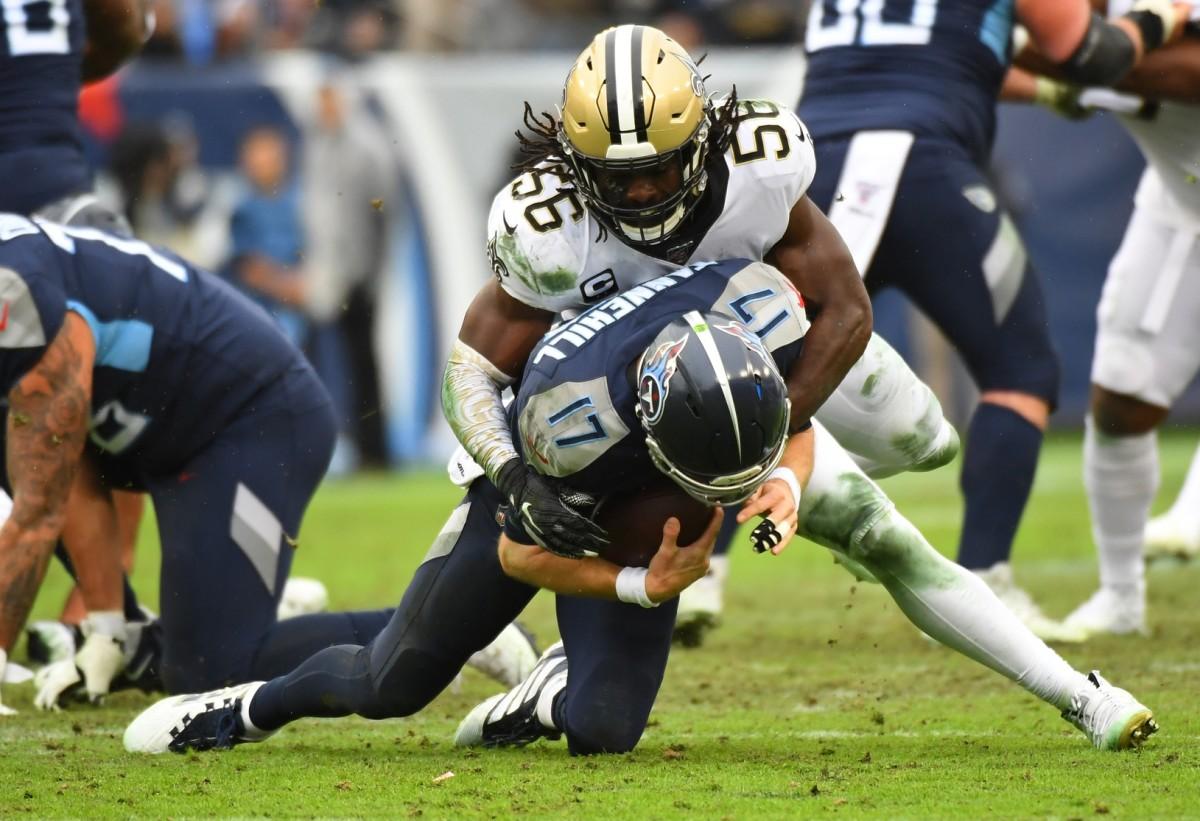 Dec 22, 2019; Nashville, Tennessee, USA; Saints linebacker Demario Davis (56) sacks Titans quarterback Ryan Tannehill (17). Mandatory Credit: Christopher Hanewinckel-USA TODAY