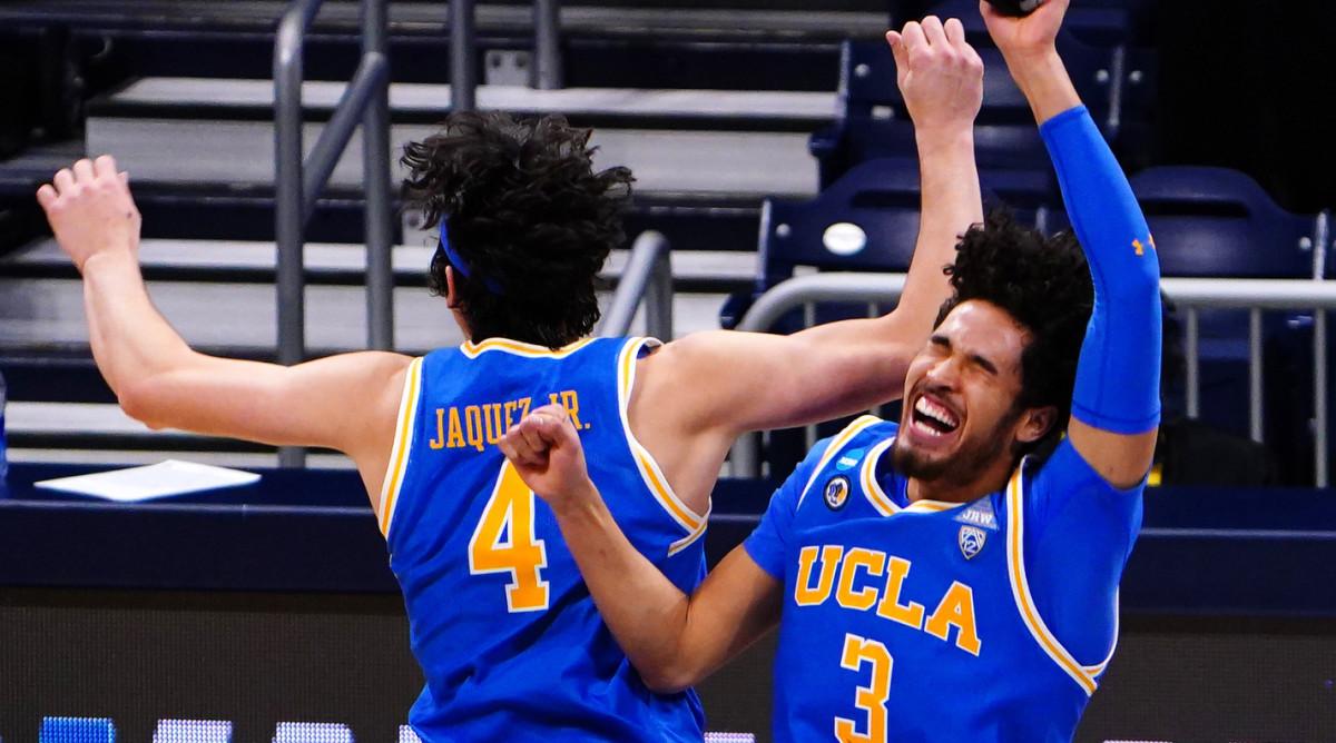 UCLA Bruins guard Jaime Jaquez Jr. (4) and UCLA Bruins guard Johnny Juzang (3) celebrate the win over Alabama Crimson Tide