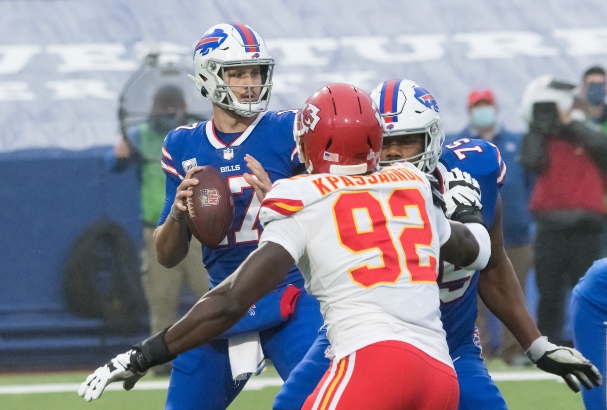 Oct 19, 2020; Orchard Park, New York; Buffalo quarterback Josh Allen (17) stands in the pocket while being pressured by Chiefs defensive end Tanoh Kpassagnon (92). Mandatory Credit: Mark Konezny-USA TODAY