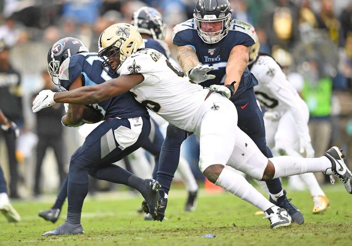 New Orleans defensive end Carl Granderson (96) stops Titans running back Dalyn Dawkins (28)© George Walker IV / Tennessean.com, Nashville Tennessean via Imagn Content Services, LLC