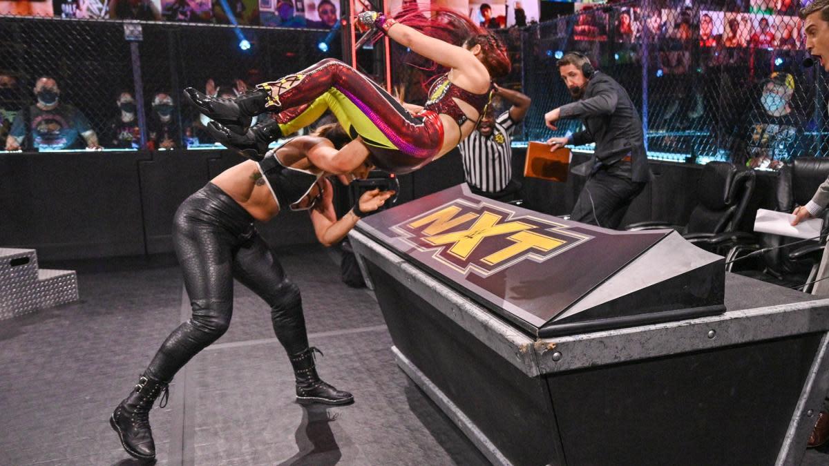 WWE's Raquel Gonzalez throws Io Shirai through a table on NXT