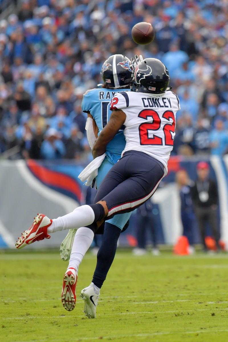 Dec 15, 2019; Texans cornerback Gareon Conley (22) blocks a pass intended for Titans receiver Kalif Raymond (14). Mandatory Credit: Jim Brown-USA TODAY Sports