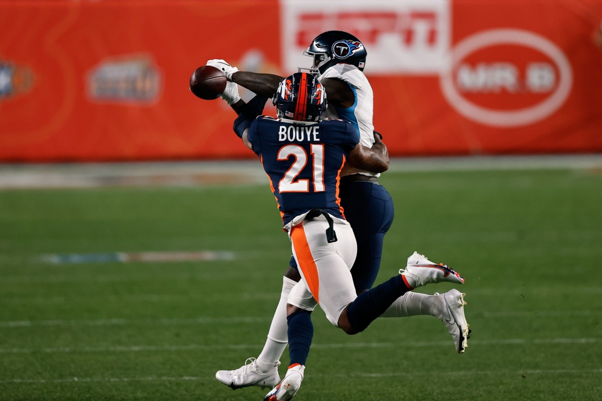 Sep 14, 2020; Denver Broncos cornerback A.J. Bouye (21) breaks up a pass intended for Titans receiver A.J. Brown (11). Mandatory Credit: Isaiah J. Downing-USA TODAY