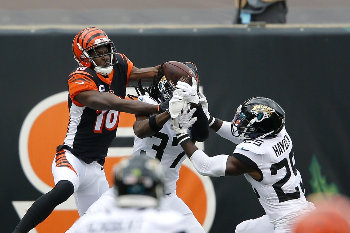Oct 4, 2020; Bengals wide receiver A.J. Green (18) goes up for the pass while defended by Jaguars cornerbacks Tre Herndon (37) and D.J. Hayden (25). Mandatory Credit: Joseph Maiorana-USA TODAY