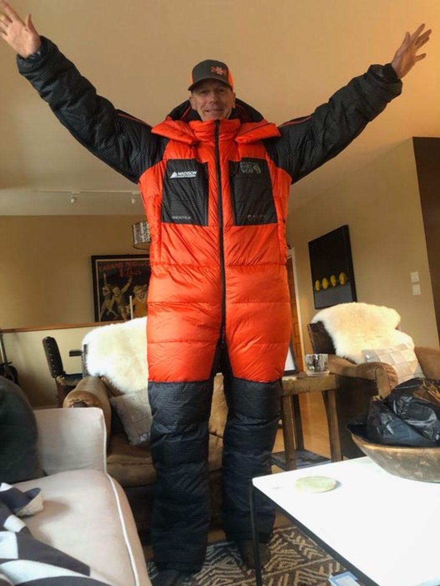 Mark Pattison models his mountain-climbing suit.