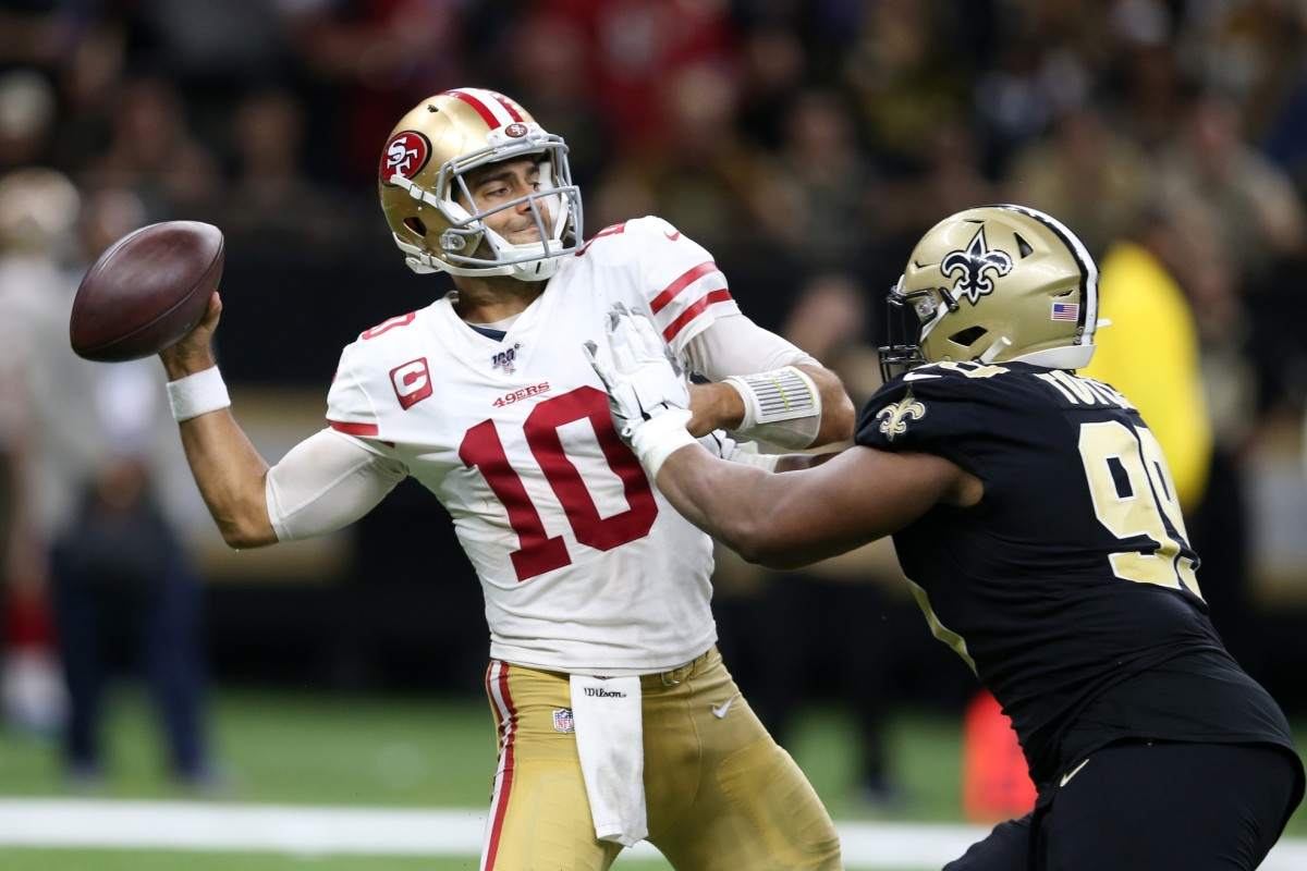 San Francisco 49ers quarterback Jimmy Garoppolo (10) is pressured by New Orleans Saints defensive tackle Shy Tuttle (99). Mandatory Credit: Chuck Cook-USA TODAY