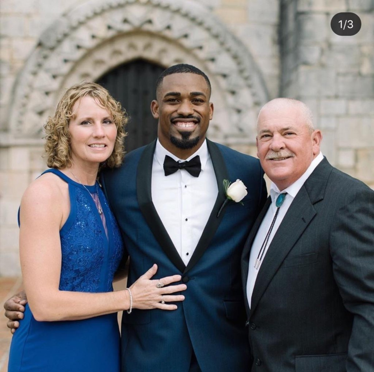"""Mostert at his 2017 wedding with his Pop Warner coach Mike """"Porkchop"""" Stokes and his wife DeAnne. (Shea Christine Photography)"""