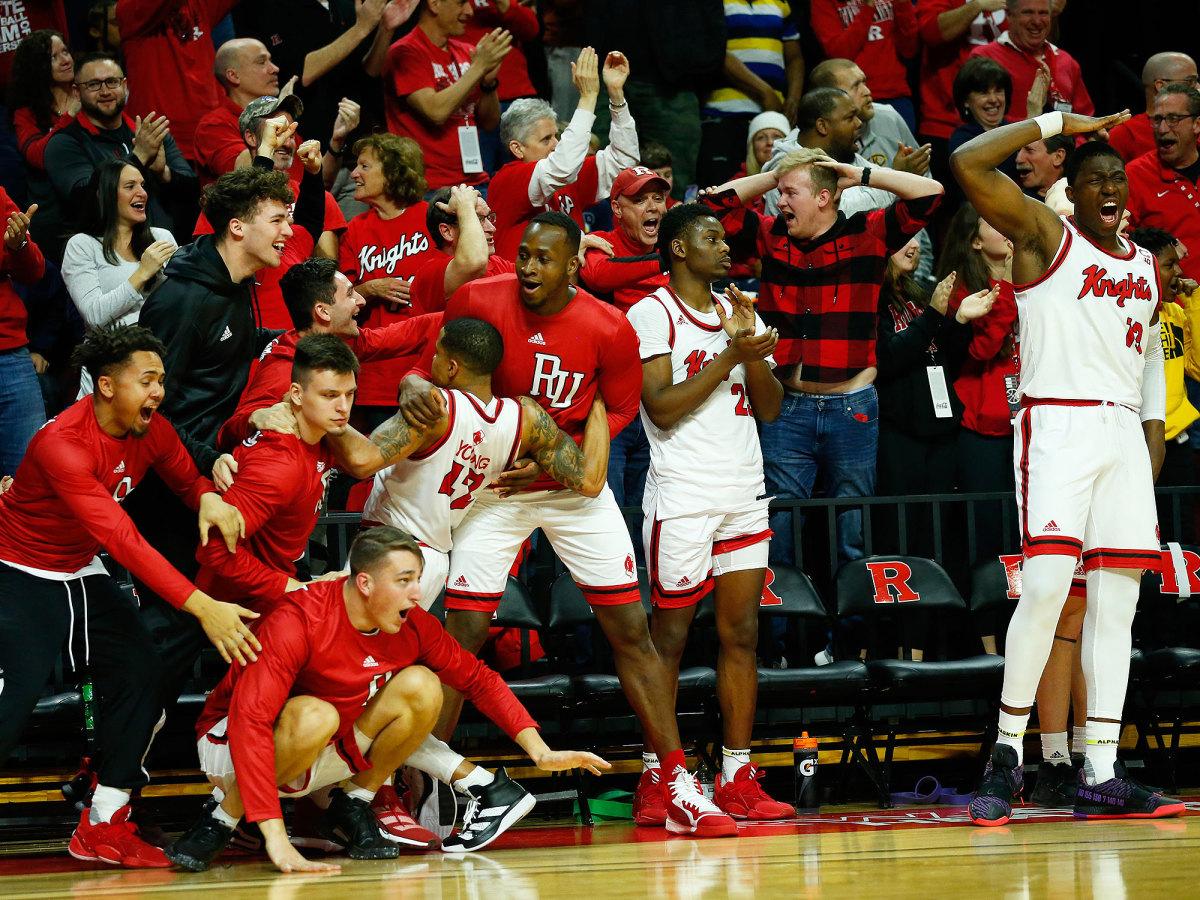Rutgers basketball players celebrate