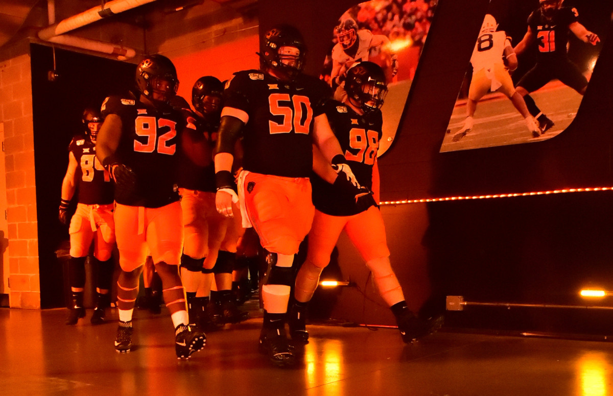 Oklahoma State players prepare to come out for the start of the Kansas State game this past season.