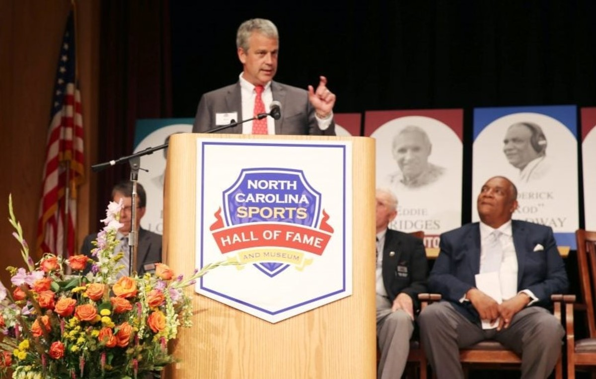 NC State AD Boo Corrigan accepts his father Gene's induction into the NC Sports Hall of Fame last summer