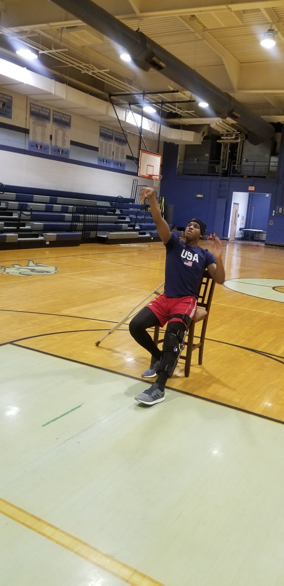 M.J. Rice shoots jump shots despite being in a cast.