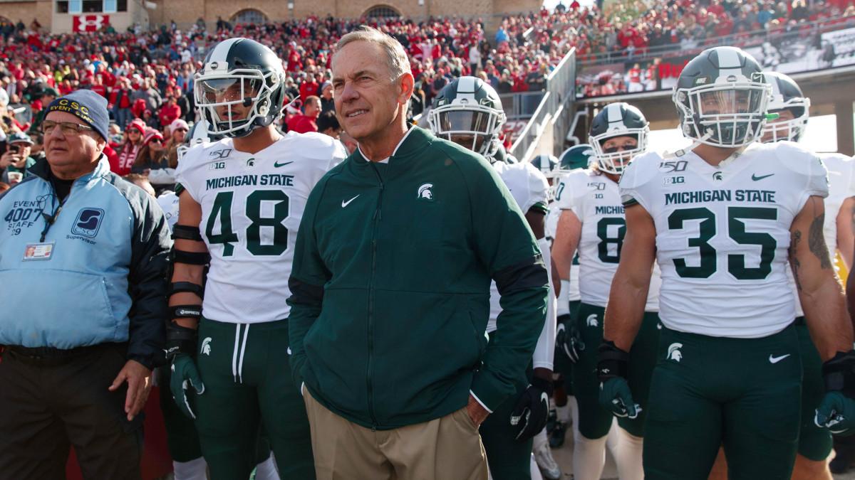 Michigan State head coach Mark Dantonio walks on the field with his players