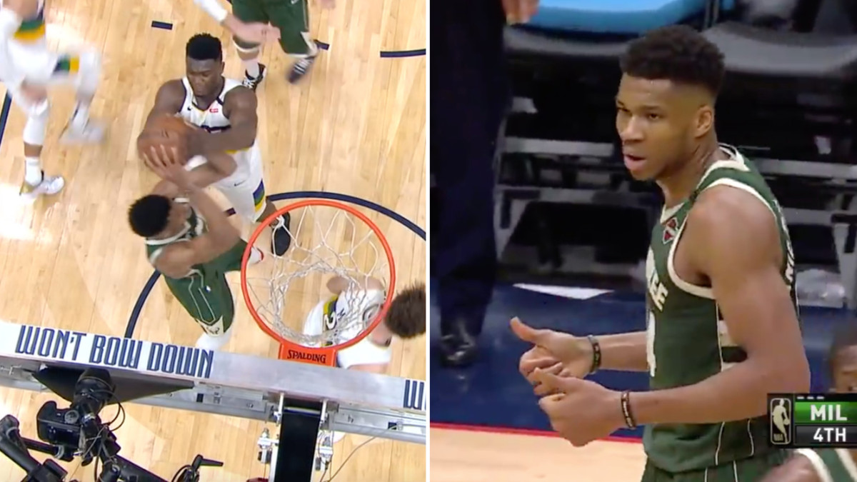 Zion Williamson and Giannis Antetokounmpo fight for a rebound in Pelicans-Bucks game