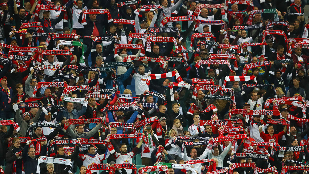 RB Leipzig fans raise their scarves at Red Bull Arena