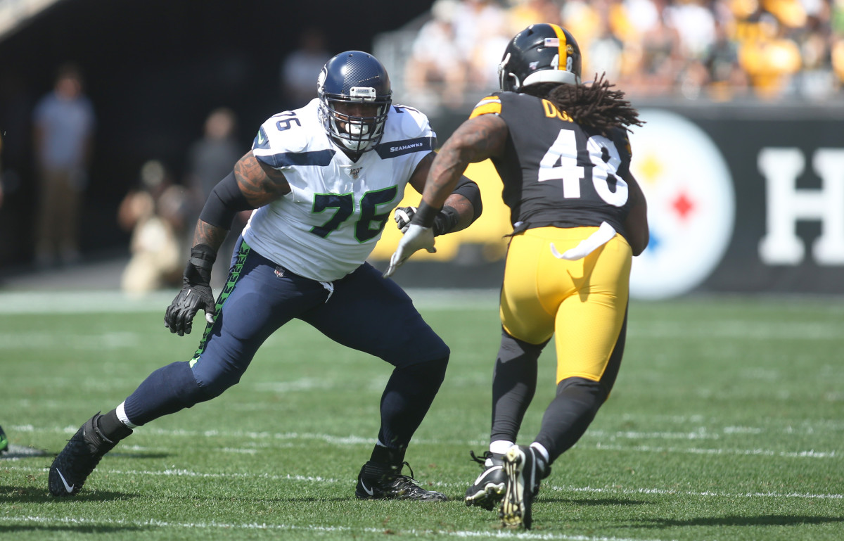 Seattle Seahawks offensive tackle Duane Brown (76) blocks at the line of scrimmage against Pittsburgh Steelers outside linebacker Bud Dupree (48) during the first quarter at Heinz Field. The Seahawks won 28-26.