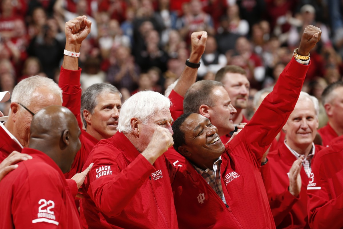 Bob Knight and dozens of his players, including Hall of Famer Isiah Thomas, cheer at center court at Assembly Hall on Saturday. (USA TODAY)