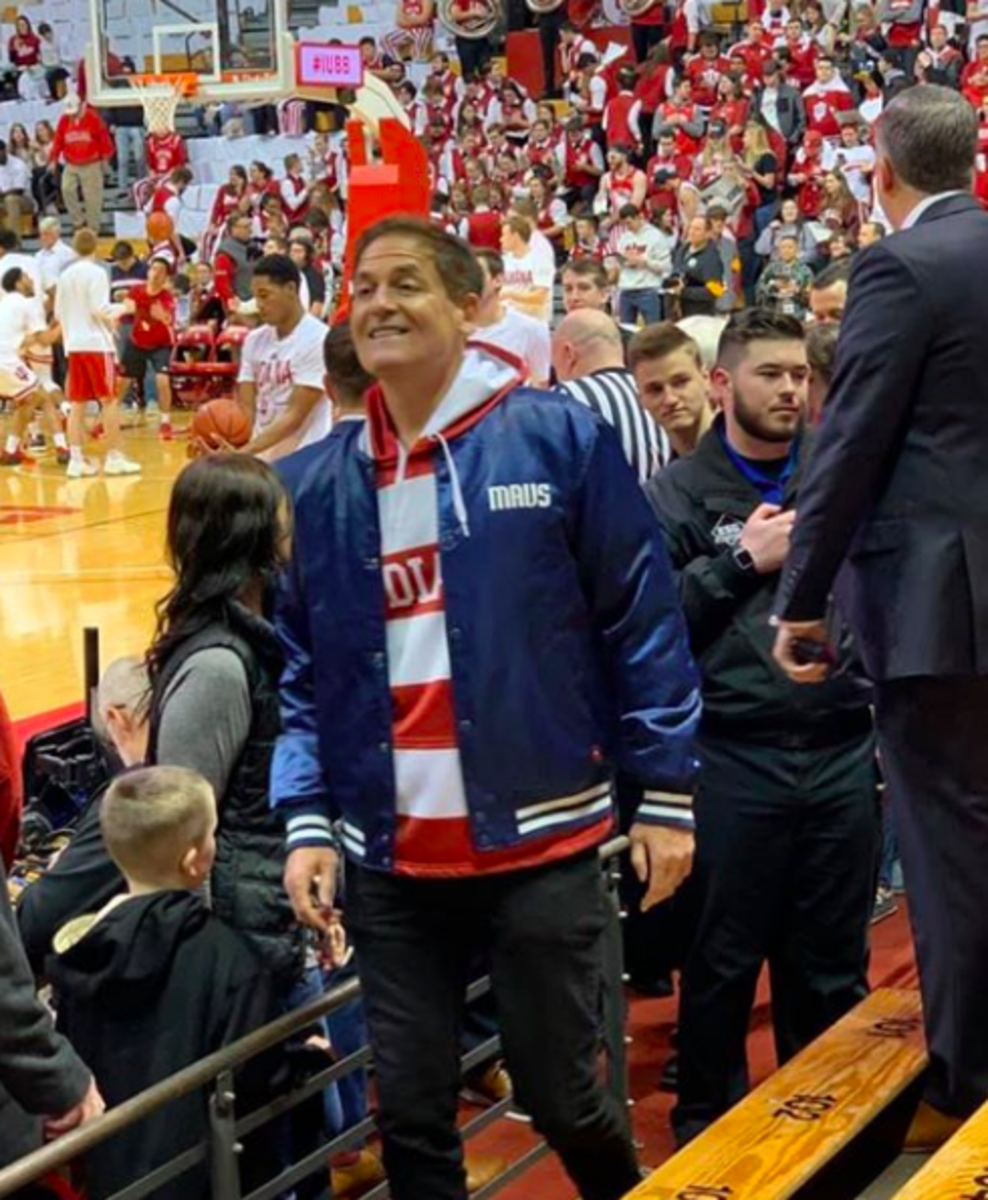 Mark Cuban heads to his seats at center court by the Indiana bench.