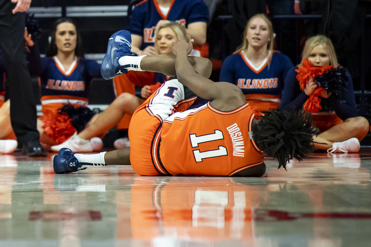 Illinois Fighting Illini guard Ayo Dosunmu (11) reacts after a last-second left leg injury against the Michigan State Spartans at State Farm Center.