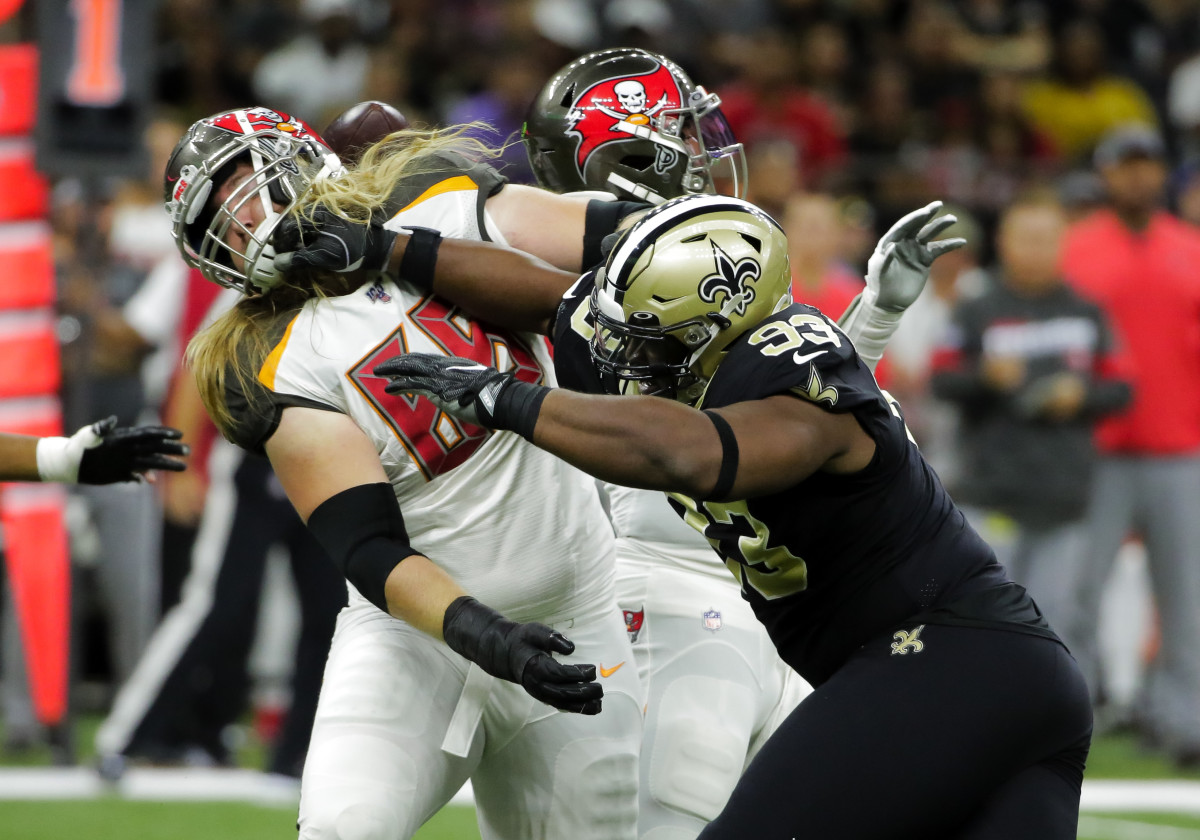 Oct 6, 2019; New Orleans, LA, USA; New Orleans Saints defensive tackle David Onyemata (93) rushes against Tampa Bay Buccaneers offensive guard Alex Cappa (65) during the first quarter at the Mercedes-Benz Superdome. Mandatory Credit: