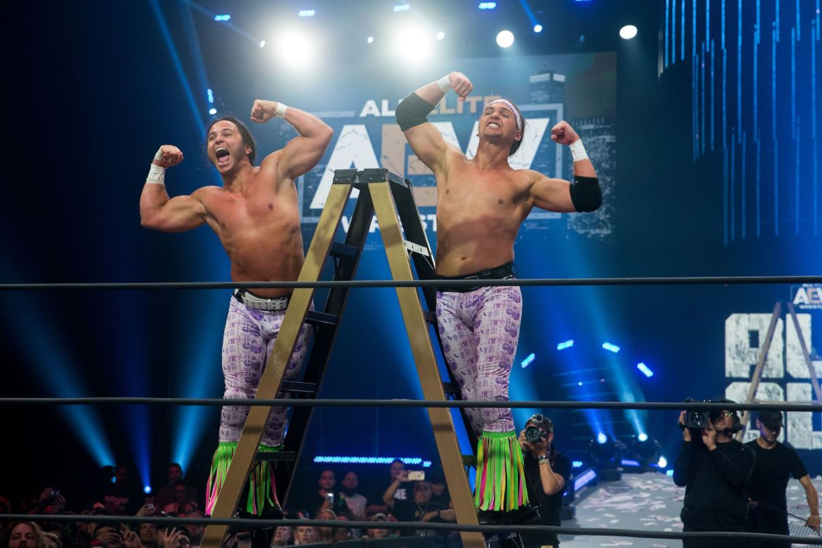 Matt and Nick Jackson (The Young Bucks) pose in the ring at AEW All Out