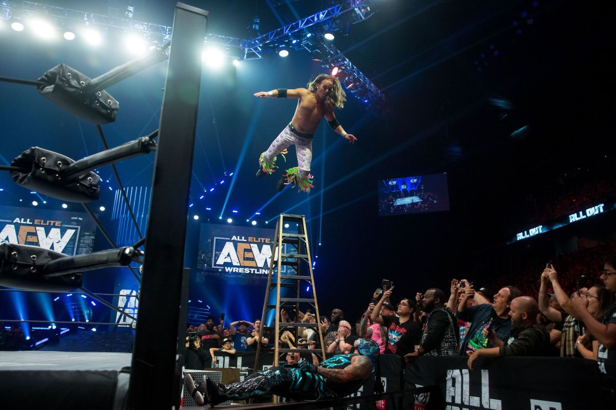 Nick Jackson of the Young Bucks dives onto Pentagon Jr. during their ladder match at AEW All Out