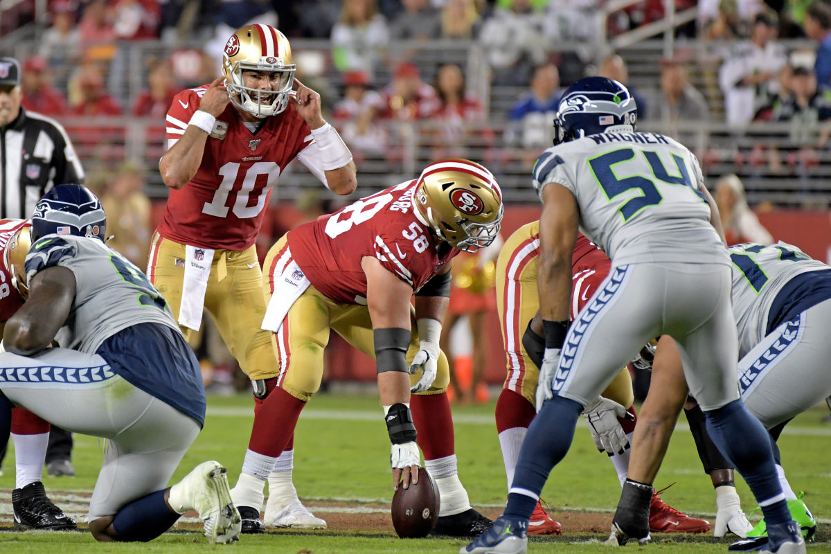 San Francisco 49ers quarterback Jimmy Garoppolo (10) yells out from the line of scrimmage against linebacker Bobby Wagner and the Seattle Seahawks during the first half at Levi's Stadium.