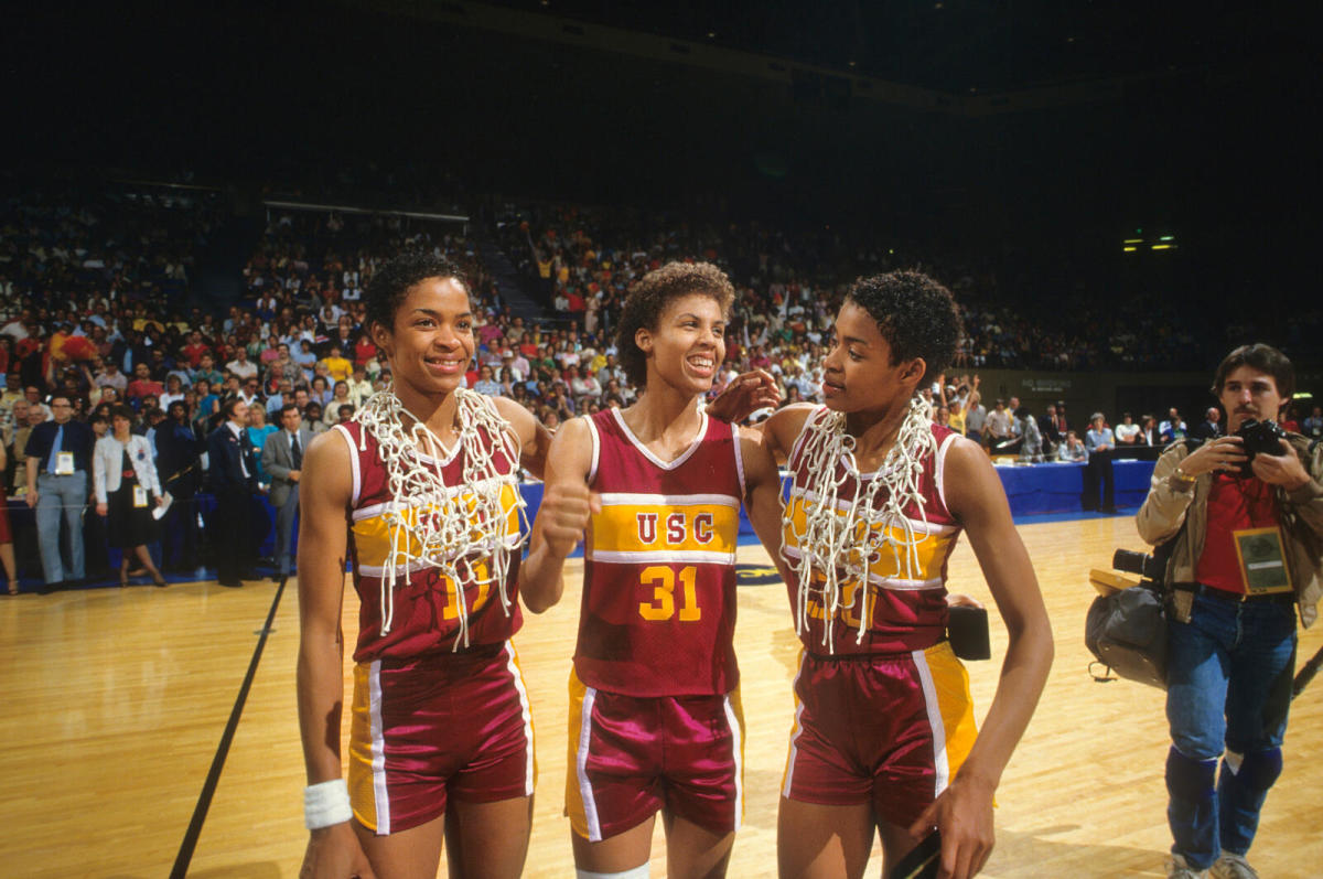 Miller, flanked by teammates Paula (left) and Pam McGee, won two national championships with USC.
