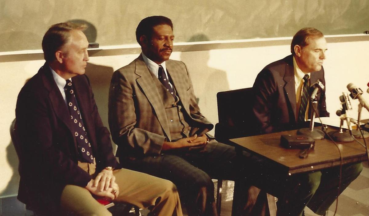 Coach Bostick (far left) at the Alabama press conference introducing Wimp Sanderson as the new head coach. (photo by Jimmy Bank)