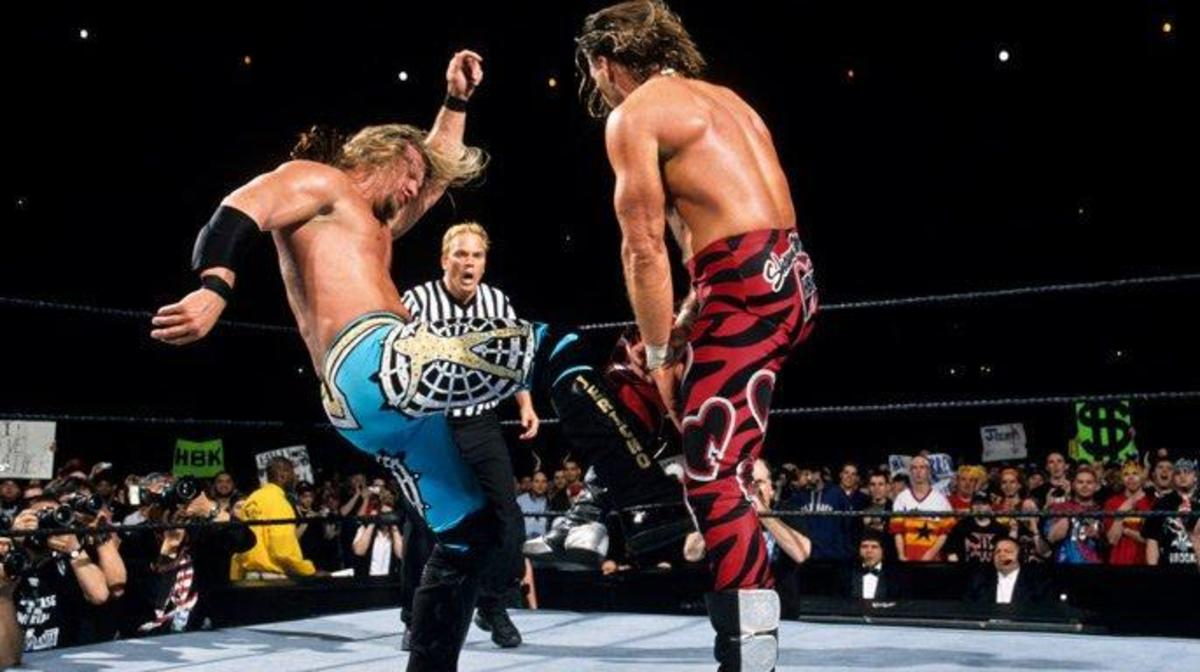 Chris Jericho and Shawn Michaels wrestle in the ring during WrestleMania 19