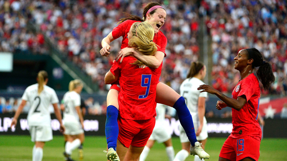 Rose Lavelle, Lindsey Horan and Crystal Dunn celebrate a USWNT goal