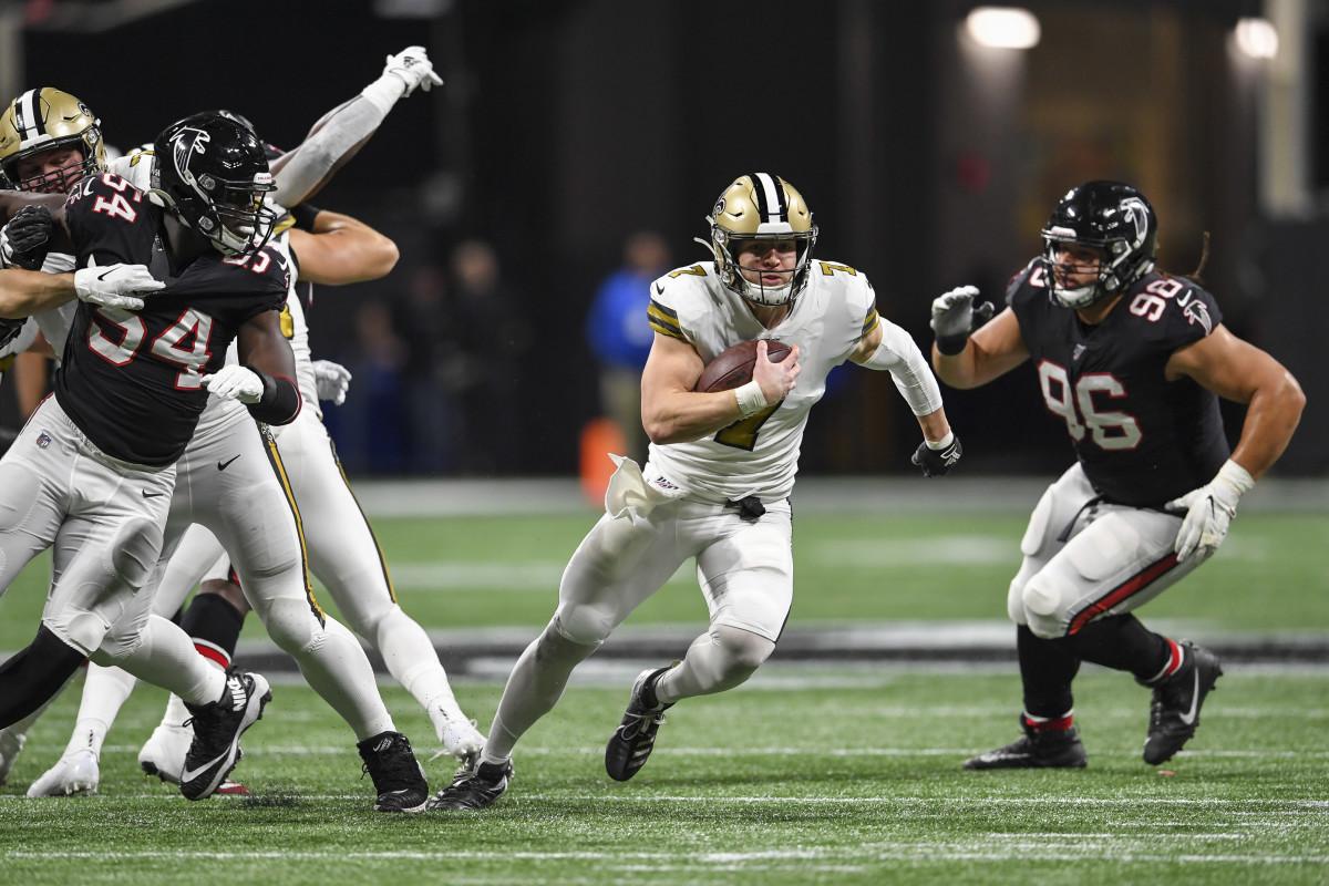 Nov 28, 2019; Atlanta, GA, USA; New Orleans Saints quarterback Taysom Hill (7) runs through the Atlanta Falcons defense for a touchdown during the first half at Mercedes-Benz Stadium. Mandatory Credit: D