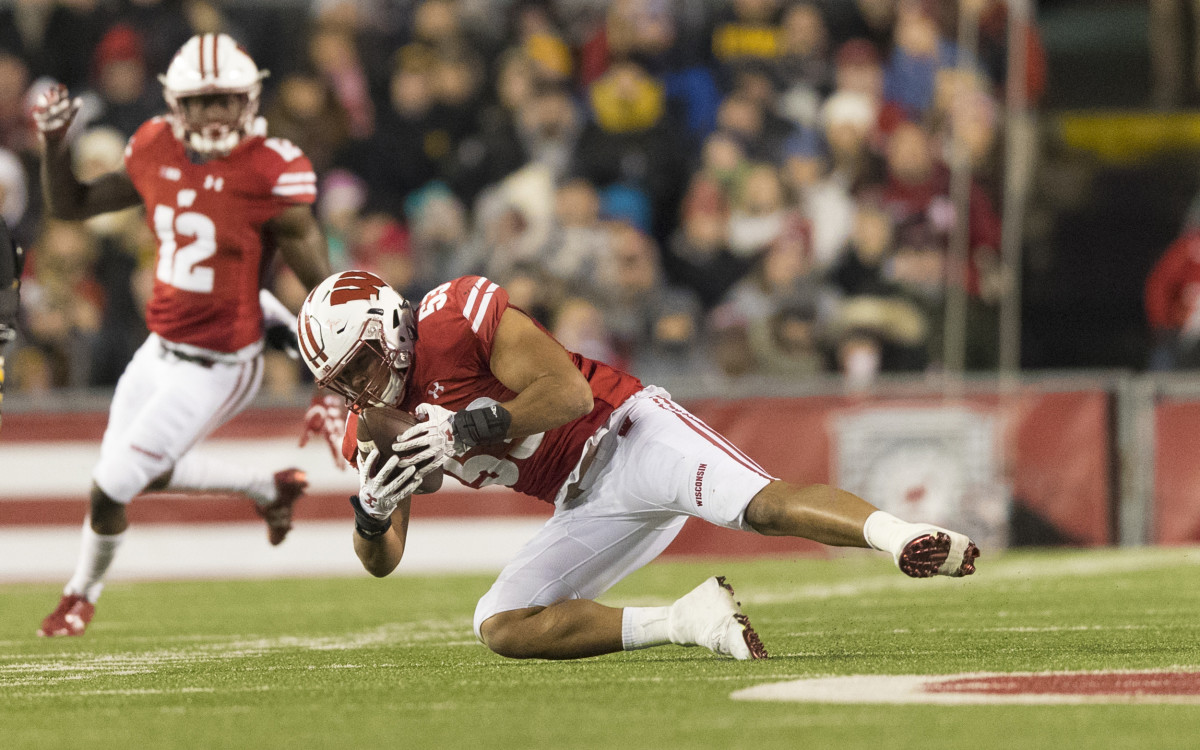 Wisconsin Badgers linebacker Christian Bell (55) intercepts a pass during the third quarter against the Iowa Hawkeyes at Camp Randall Stadium.