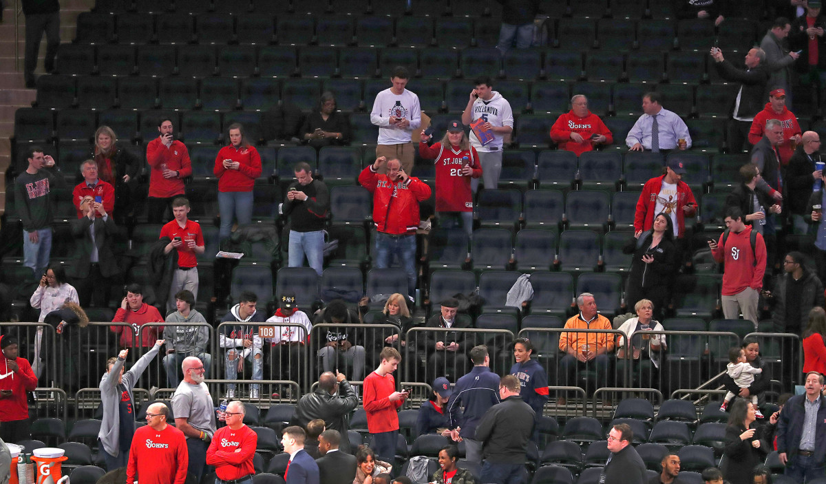 Fans after the mid-game cancellation of the Big East tournament at Madison Square Garden.