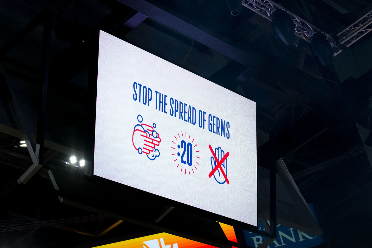 A message about germs on a screen at Vivint Smart Home Arena prior to a game between the Utah Jazz and the Toronto Raptors.