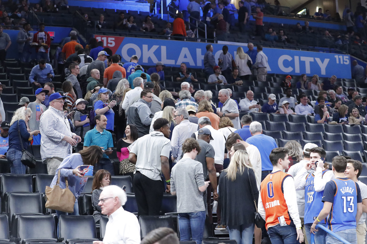 Fans leave after being told the Oklahoma City Thunder vs. Utah Jazz  game had been cancelled just before tip off.