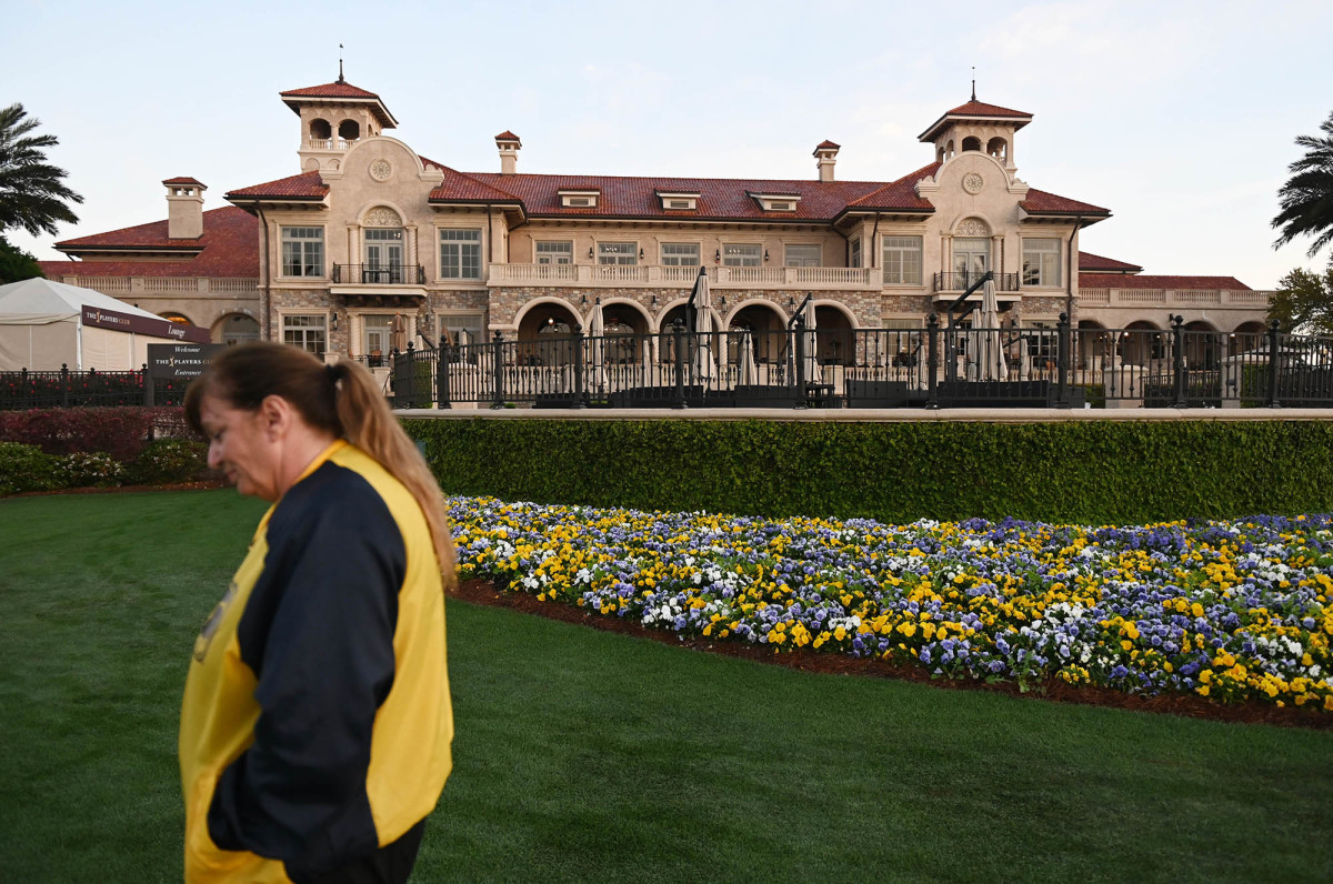 A security guard walks by after the cancellation of The Players Championship at TPC Sawgrass.