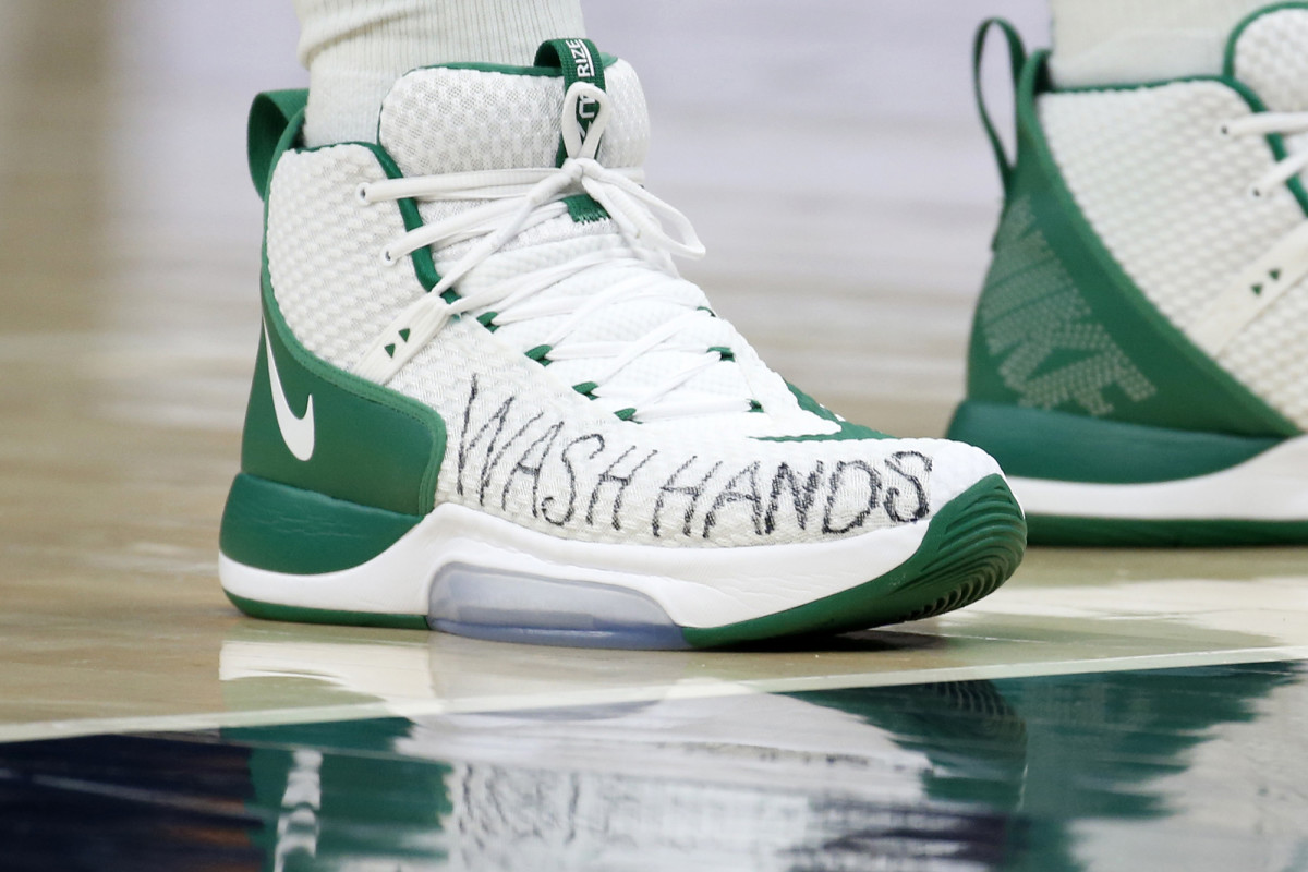 Boston Celtics center Enes Canter wears a message on his shoes for people to wash their hands.