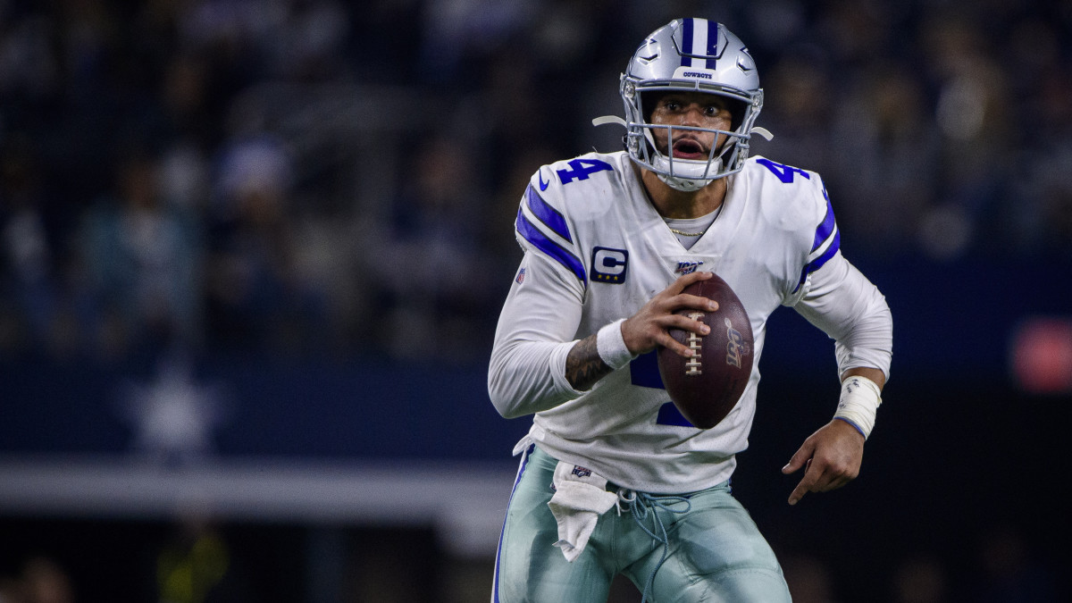 Dallas Cowboys quarterback Dak Prescott in action during the game between the Bills and Cowboys at AT&T Stadium.