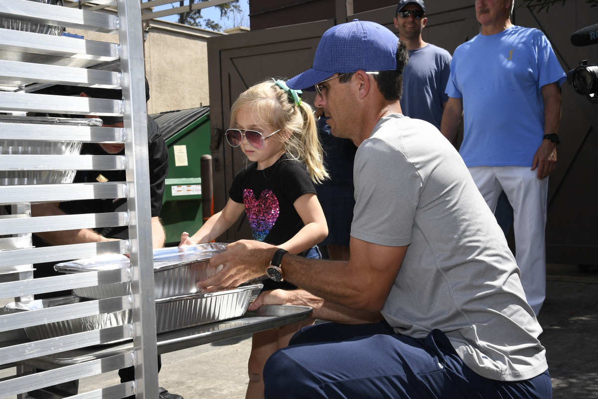 PGA Tour pro Billy Horschel and his daughter load food from The Players Championship to be donated to Feeding Northeast Florida.