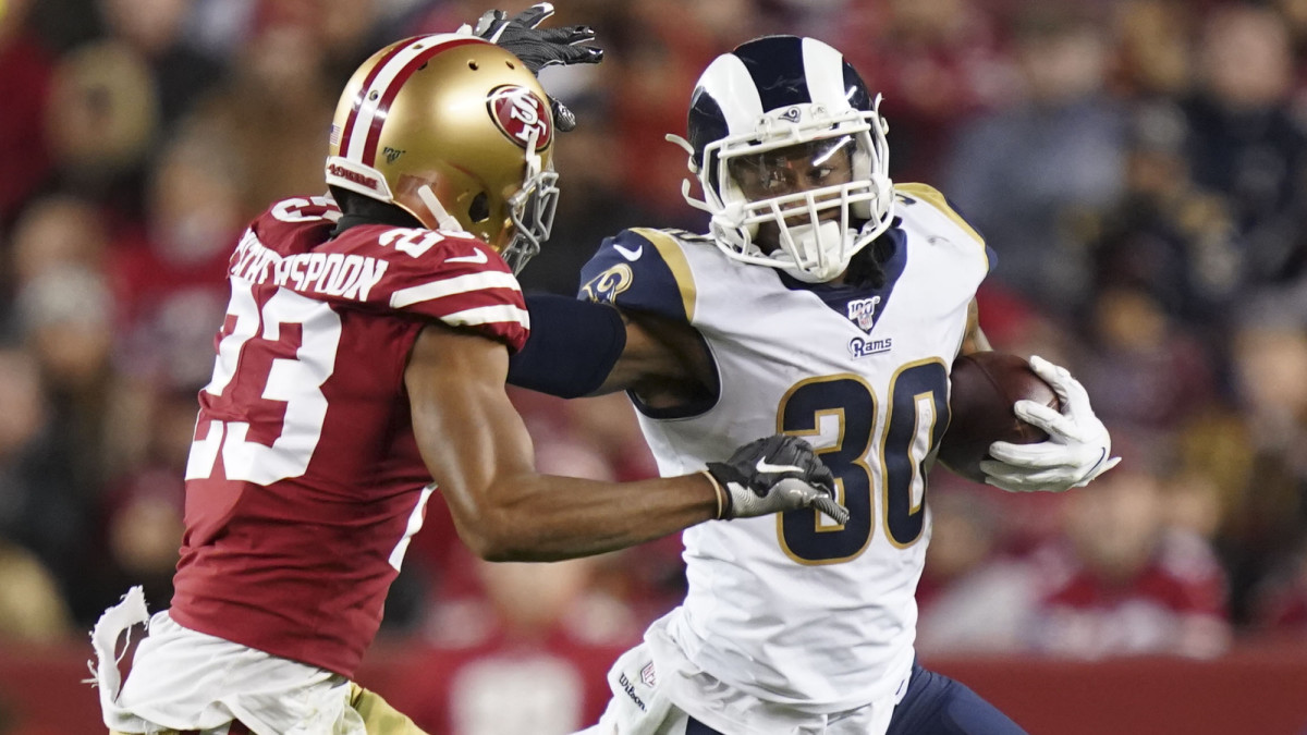 Los Angeles Rams running back Todd Gurley runs with the football against San Francisco 49ers cornerback Ahkello Witherspoon during the third quarter at Levi's Stadium.